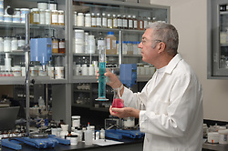 Senior chemist formulating in a laboratory