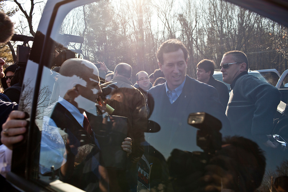 "Republican presidential candidate Rick Santorum leaves after participating in ""The Electorate and the Economy"" forum at St. Anselm College on Saturday, January 7, 2012 in Manchester, NH. Brendan Hoffman for the New York Times"