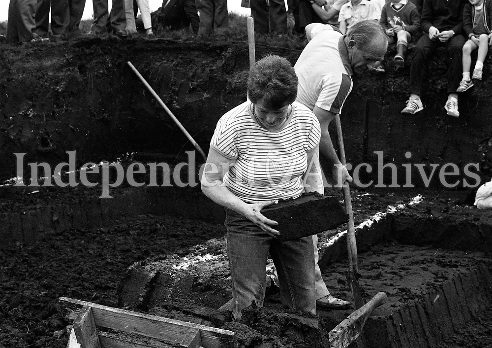 Neil Malone, the only Lady Captain in the All-Ireland Turf Cutting Competition at Meeding Bog, Westmeath, 17/06/1984 (Part of the Independent Newspapers Ireland/NLI Collection).