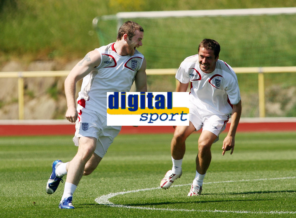 Photo: Chris Ratcliffe.<br />England Training Session. FIFA World Cup 2006. 13/06/2006.<br />Wayne Rooney and Michael Owen warm up during training.