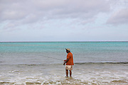 A man fishing in the surf at Love beach Nassau, Bahamas, Caribbean