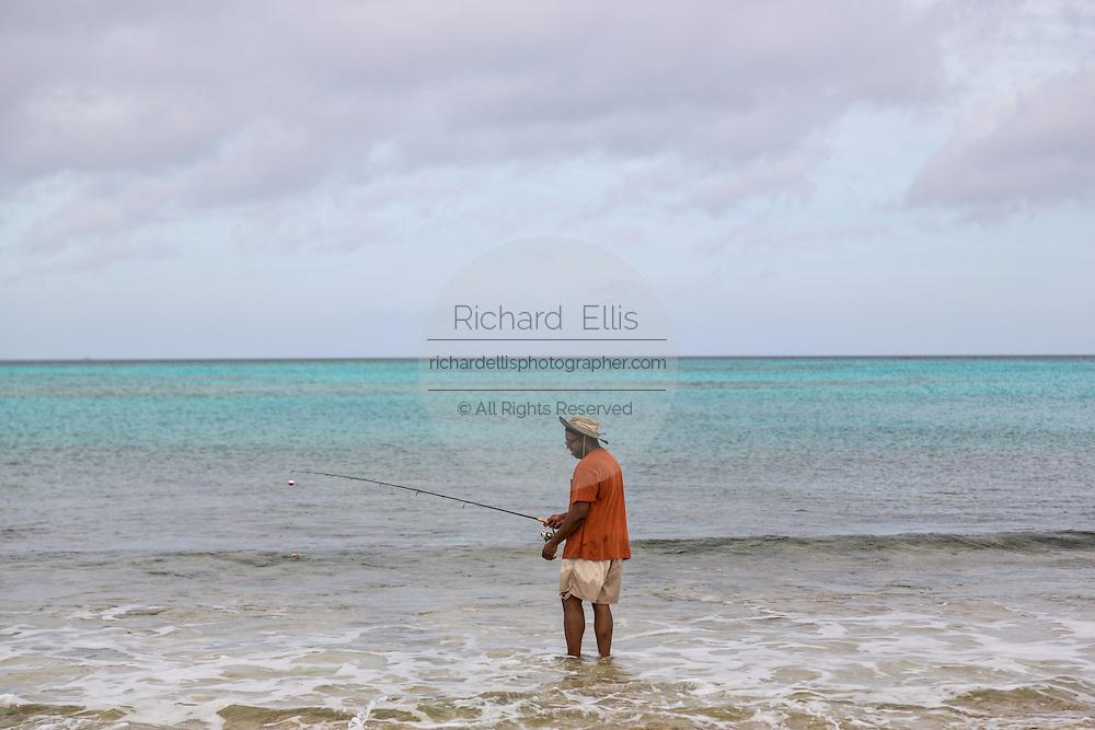 A man fishing in the surf at Love beach Nassau, Bahamas, Caribbean