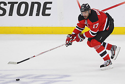 May 30; Newark, NJ, USA; New Jersey Devils left wing Ilya Kovalchuk (17) skates with the puck during the second period of 2012 Stanley Cup Finals Game 1 at the Prudential Center.  The Kings defeated the Devils 2-1.