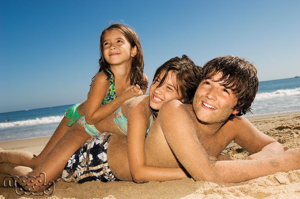 Children in swimwear playing beach