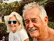 """Berta and George """"Smitty"""" Smith enjoy another fine morning sitting on a sea wall near the ocean on Tuesday, June 5, 2018, in Kona, Hawaii. Photo by LE Baskow"""