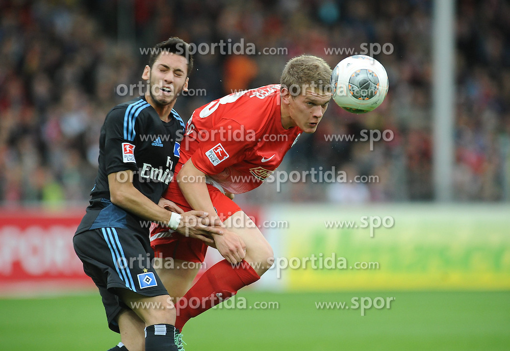 27.10.2013, Mage Solar Stadion, Freiburg, GER, 1. FBL, SC Freiburg vs Hamburger SV, 10. Runde, im Bild Kopfballduell, Aktion zwischen (l ) Hakan Calhanoglu (Hamburger SV) (r ) Matthias Ginter (SC Freiburg) // during the German Bundesliga 10th round match between SC Freiburg and Hamburger SV at the Mage Solar Stadion in Freiburg, Germany on 2013/10/27. EXPA Pictures &copy; 2013, PhotoCredit: EXPA/ Eibner-Pressefoto/ Laegler<br /> <br /> *****ATTENTION - OUT of GER*****