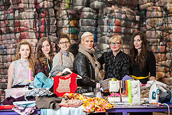 Students Emam McDowall, Lucu Morrant, Hannah McKinnon, Model Anna Freemantle, Scottish fashion designer Niki Taylor and student Allison Radcliffe. Showing fashion students about upcycling clothes, at the UK&rsquo;s second largest textile recycling facility, Nathan&rsquo;s Wastesavers, in Denny.<br /> &copy; Michael Schofield.