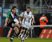 Twickenham, GREAT BRITAIN, Quins, Adrian JARVIS, kicks clear watched by Ospreys, Marty HOLAH, during the EDF. Energy Cup. between, Harlequins vs Ospreys at Twickenham Stoop.  02/12/2007 [Mandatory Credit Peter Spurrier/Intersport Images].