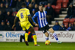 Chris McCann of Wigan is challenged by Jose Semedo of Sheffield Wednesday - Photo mandatory by-line: Rogan Thomson/JMP - 07966 386802 - 30/12/2014 - SPORT - FOOTBALL - Wigan, England - DW Stadium - Wigan Athletic v Sheffield Wednesday - Sky Bet Championship.