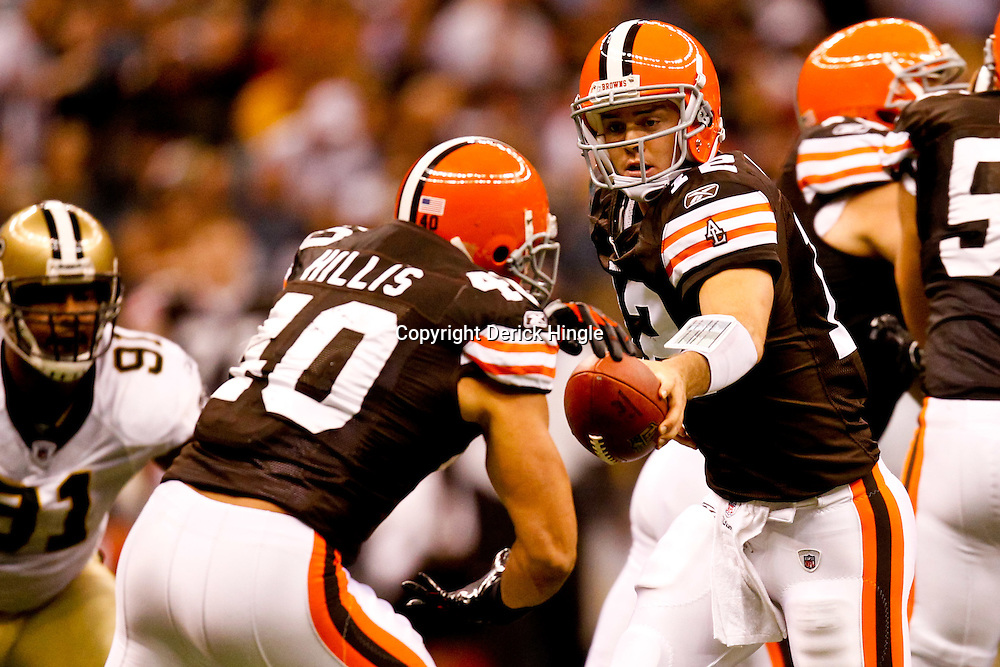 Oct 24, 2010; New Orleans, LA, USA; Cleveland Browns quarterback Colt McCoy (12) hands off the ball to running back Peyton Hillis (40) during the first half against the New Orleans Saints at the Louisiana Superdome. Mandatory Credit: Derick E. Hingle