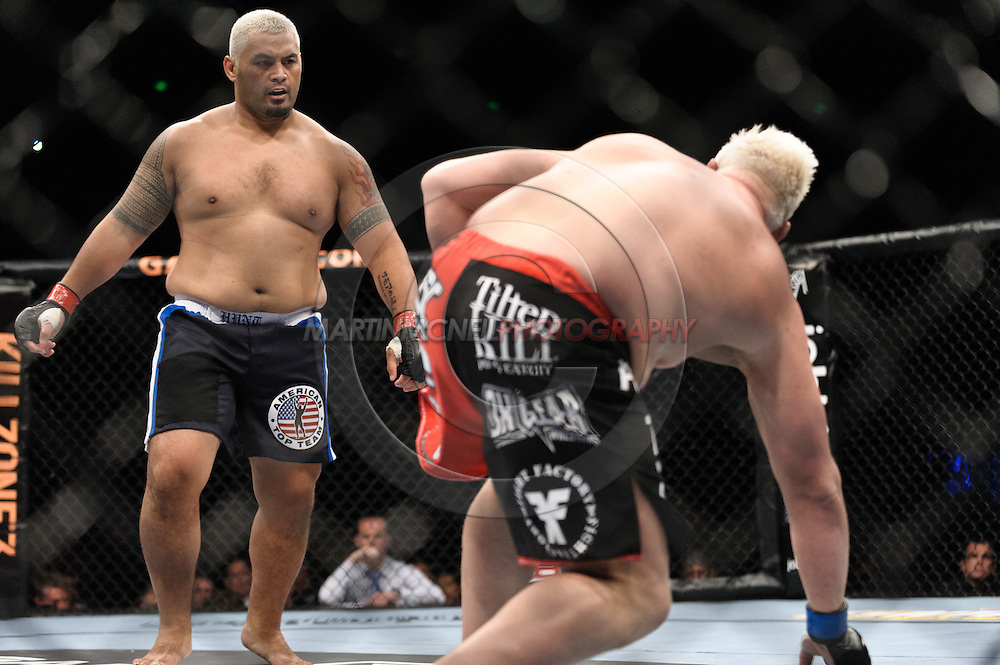 "SYDNEY, AUSTRALIA, FEBRUARY 27, 2011: Mark Hunt (left) pursues a stunned Chris Tuchscherer during ""UFC 127: Penn vs. Fitch"" inside Acer Arena in Sydney, Australia on February 27, 2011."