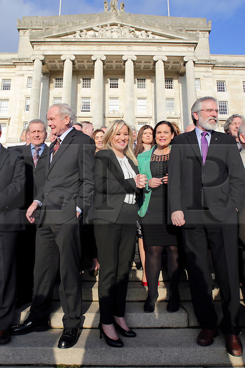 © Licensed to London News Pictures. STORMONT BELFAST - 23 JAN 2017:  Sinn Fein's Michelle O'Neill stands between Martin McGuinness and Gerry Adams on the steps of Stormont after being named as the new leader of Sinn Fein in the North, taking over from former deputy first minister Martin McGuinness who has retired due to illness.. Photo credit: London News Pictures.