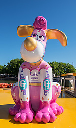 "© Licensed to London News Pictures.  27/06/2018; Bristol, UK. ""Merry-Go"" Gromit character at the Gromit Unleashed 2, official launch at Bristol Harbourside. Gromit Unleashed 2 will see the Academy Award®-winning character Gromit by Nick Park at Aardman Animations returning to Bristol in 2018 for the second time on sculpture trails to raise money for  the Grand Appeal charity. The character of Gromit will be joined by Wallace and arch nemesis Feathers McGraw.<br /> The trail will feature over 60 giant sculptures, including a new WG Grace cricketing Gromit, designed by high-profile artists, designers, innovators and local talent. Sculptures will be positioned in high footfall and iconic locations around Bristol and the surrounding area, for a family day out around the city and beyond. Photo credit: Simon Chapman/LNP"