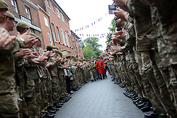 © Licensed to London News Pictures. 28/06/2014. Lichfield, UK The last parade by 3 Bn The Mercian Regiment at Lichfield. The Regt marched through the city and past the Kings Head pub where they were formed, past the Guild Hall and back to the Cathedral. . Photo credit : Sgt Russ Nolan/LNP