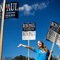 AMBER NORTH waives Ron Paul banners across the street from a Republican Presidential candidate Rick Santorum event at Crady's restaurant.  The South Carolina primary will be held on January 21.