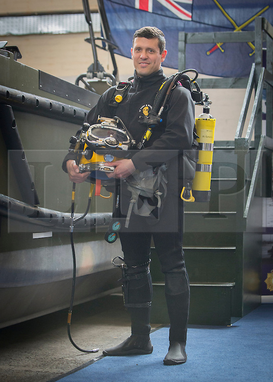 26/03/2014.  Lance Corporal Jeanne Du Preez (34) a Royal Logistics Core diver displays some of his equipment as the British Army reveal it's new specialist, combat and command skills formation today. This new part of the Army will be made up of 36000 Regular and Reserve soldiers, which is a third of the army as a whole and supports the logistics of operations both in the UK and abroad.  The command will officially launch on the 1 Apr 14.  Alison Baskerville/LNP