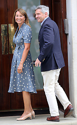 Duchess of Cambridge's parents Carol and Michael arriving at St.Mary's hospital in London following the birth of the Royal baby Tuesday, 23rd July 2013<br /> Picture by Stephen Lock / i-Images