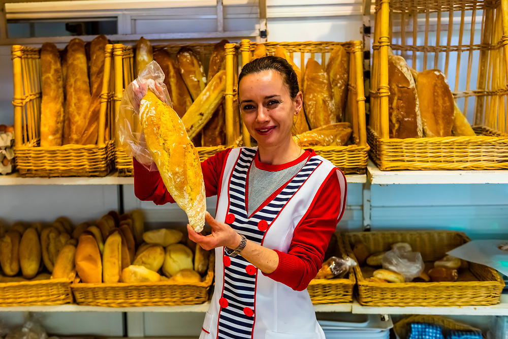 Woman selling bread in the Panaderia Maria, Granada, Granada Province, Andalusia, Spain.