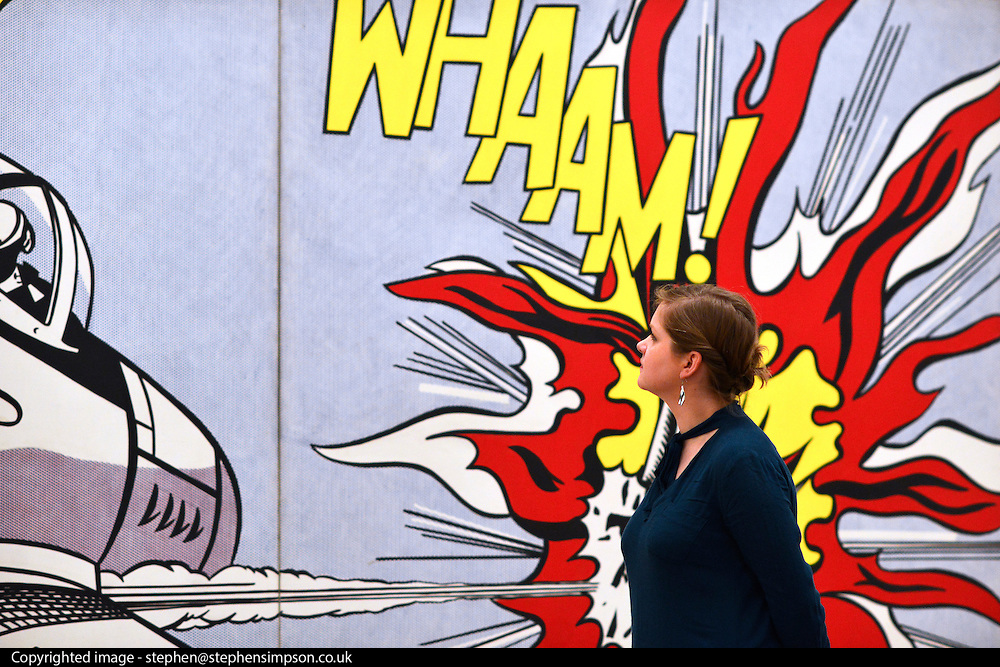 """© Licensed to London News Pictures. 18/02/2013. London, UK A woman stands in front of """"Whaam!"""" 1963. Press view for Tate Modern's """"Lichtenstein: A Retrospective"""". It is the first major Lichtenstein retrospective for twenty years, bringing together 125 of the artists most definitive paintings. The exhibition is open to the public from 21 February -  27 May 2013.  Photo credit : Stephen Simpson/LNP"""