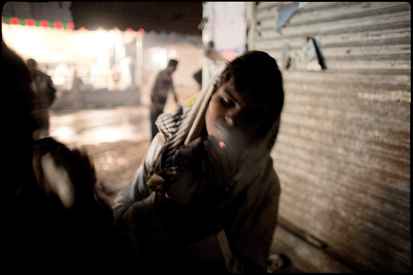 "Young boys, homeless and drug addicts, sniff glue through rags. Lahore, Pakistan, on sunday, November 30 2008.....""Pakistan is one of the countries hardest hits by the narcotics abuse into the world, during the last years it is facing a dramatic crisis as it regards the heroin consumption. The Unodc (United Nations Office on Drugs and Crime) has reported a conspicuous decline in heroin production in Southeast Asia, while damage to a big expansion in Southwest Asia. Pakistan falls under the Golden Crescent, which is one of the two major illicit opium producing centres in Asia, situated in the mountain area at the borderline between Iran, Afghanistan and Pakistan itself. .During the last 20 years drug trafficking is flourishing in the Country. It is the key transit point for Afghan drugs, including heroin, opium, morphine, and hashish, bound for Western countries, the Arab states of the Persian Gulf and Africa..Hashish and heroin seem to be the preferred drugs prevalence among males in the age bracket of 15-45 years, women comprise only 3%. More then 5% of whole country's population (constituted by around 170 milion individuals),  are regular heroin users, this abuse is conspicuous as more of an urban phenomenon. The substance is usually smoked or the smoke is inhaled, while small number of injection cases have begun to emerge in some few areas..Statistics say, drug addicts have six years of education. Heroin has been identified as the drug predominantly responsible for creating unrest in the society."""