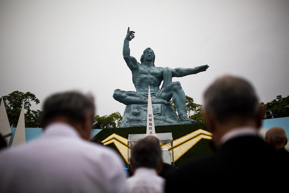 NAGASAKI, JAPAN - AUGUST 9 : Visitors pray for the atomic bomb victims in front of the Nagasaki Peace Park in Nagasaki, southern Japan on Wednesday, August 9, 2017. Japan marked the 72nd anniversary of the atomic bombing on Nagasaki. (Photo: Richard Atrero de Guzman/NUR Photo)