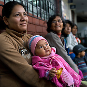 Mothers wait to be seen at the San Cosme Health Center. San Cosme is a slum in Lima that has the highest rate of tuberculosis in Lima, but has limited health services for the community. The Global Fund is supporting services in San Cosme's health center.
