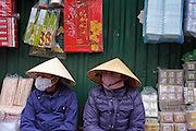 © Licensed to London News Pictures. 30/12/2011. Women at a street market in in Hanoi,  Vietnam. Photo credit : Stephen Simpson/LNP