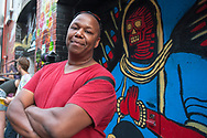 Photographer/videographer Will Jones at Freak Alley Gallery's seventh annual mural event in downtown Boise, Idaho on August 7, 2017. <br /> <br /> Freak Alley Gallery's week long event provided an &quot;art-in-motion&quot; experience as it welcomed the public to watch artists work on their murals.
