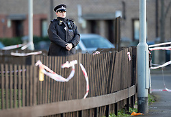© Licensed to London News Pictures. 07/03/2019. London, UK. A police officer guards the entrance to a block of flats near the crime scene in North Birkbeck Road in Leyton in east London where a murder investigation has been launched after a man in his twenties was stabbed on Wednesday. Photo credit: Peter Macdiarmid/LNP