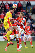 Samir Carruthers and Sam Mantom challenge for a header during the Sky Bet League 1 match between Walsall and Milton Keynes Dons at the Banks's Stadium, Walsall, England on 14 March 2015. Photo by Alan Franklin.