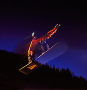 Woman (MR 758) Catching Air on a Snowboard at Night near Arapahoe Basin Ski Area, Colorado