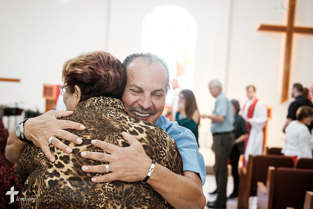 A member of the congregation warmly hugs Sylvia Gonzalez following worship at Iglesia Luterana Principe de Paz (Prince of Peace Lutheran Church), Mayagüez, Puerto Rico, and Fuente de Vida (Fountain of Life Lutheran Church), Ponce, Puerto Rico, on Sunday, April 15, 2018. Gonzalez was confirmed during the service. LCMS Communications/Erik M. Lunsford