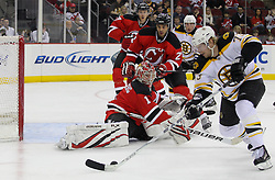 Apr 10; Newark, NJ, USA; Boston Bruins right wing Michael Ryder (73) skates with the puck towards the goal of New Jersey Devils goalie Johan Hedberg (1) during the first period of their game at the Prudential Center.