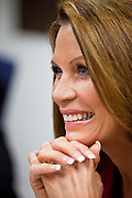 17 OCTOBER 2011 - PHOENIX, AZ: MICHELE BACHMANN, a Republican candidate for US President, listens to members of the Arizona legislators at the State Capitol in Phoenix. Bachmann met with Republican Arizona legislators and Republican members of the state's Congressional delegation Monday morning to talk about illegal immigration and border security. During the meeting she pledged that if she were elected US President, she would construct a fence along the US - Mexico border.    PHOTO BY JACK KURTZ