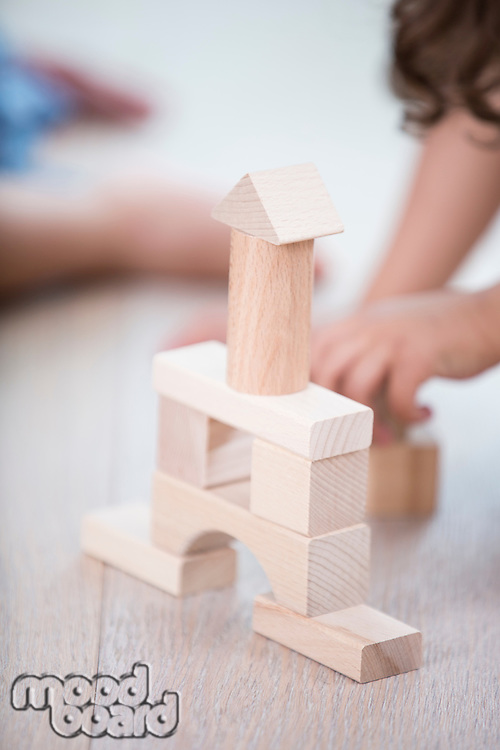 Close-up of wooden tower on hardwood floor