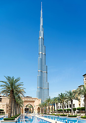 View of Burj Khalifa tower , the world's tallest structure , and the Palace Hotel in Downtown Dubai United Arab Emirates UAE