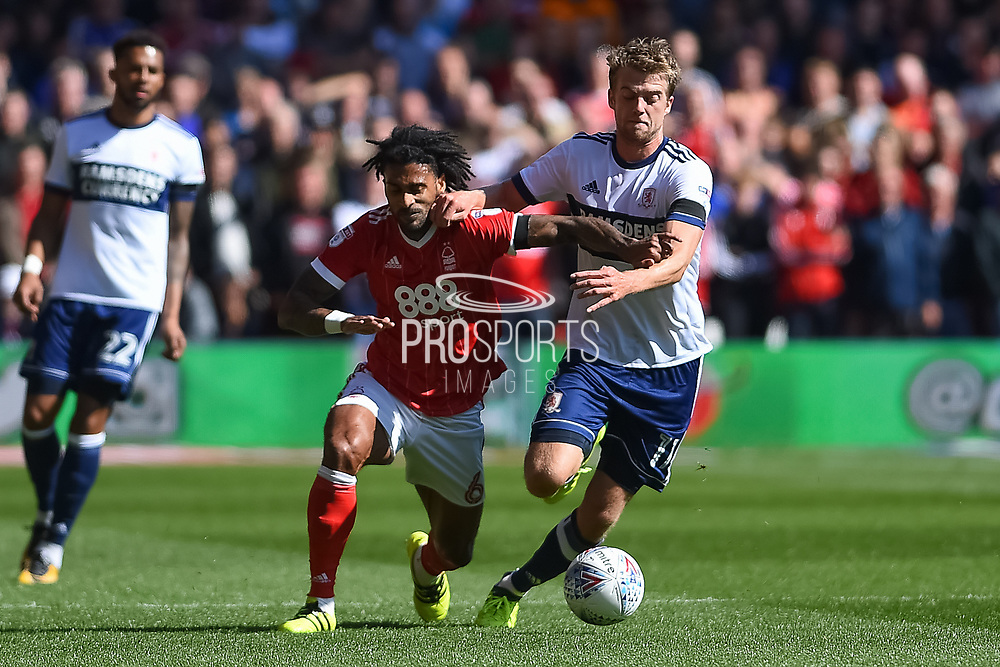 Middlesbrough forward Patrick Bamford (11) battles with Nottingham Forest defender Armand Traore (6) during the EFL Sky Bet Championship match between Nottingham Forest and Middlesbrough at the City Ground, Nottingham, England on 19 August 2017. Photo by Jon Hobley.