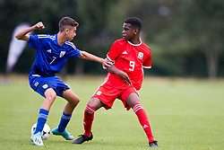 WREXHAM, WALES - Tuesday, August 13, 2019: Cyprus' Angelos Neophytou and Wales' Japhet Matondo during the UEFA Under-15's Development Tournament match between Wales and Cyprus at Colliers Park. (Pic by Paul Greenwood/Propaganda)