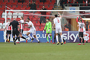 Billy Kee scores and celebrates the opening goal during the EFL Sky Bet League 2 match between Cheltenham Town and Accrington Stanley at LCI Rail Stadium, Cheltenham, England on 13 January 2018. Photo by Antony Thompson.