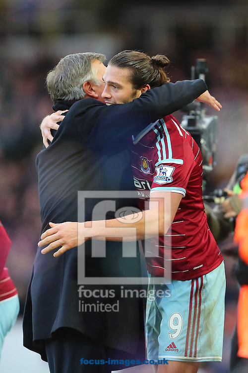 Manager of West Ham United, Sam Allardyce congratulates Andy Carroll   after he scored to make it 2-1 to West Ham United during the Barclays Premier League match at the Boleyn Ground, London<br /> Picture by Richard Calver/Focus Images Ltd +447792 981244<br /> 07/12/2014