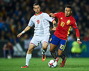 GRANADA, SPAIN - NOVEMBER 12:  Elija Nestorovski of FYR Macedonia (L) competes for the ball with Thiago Alcantara of Spain (R)during the FIFA 2018 World Cup Qualifier between Spain and FYR Macedonia at  on November 12, 2016 in Granada, .  (Photo by Aitor Alcalde Colomer/Getty Images)