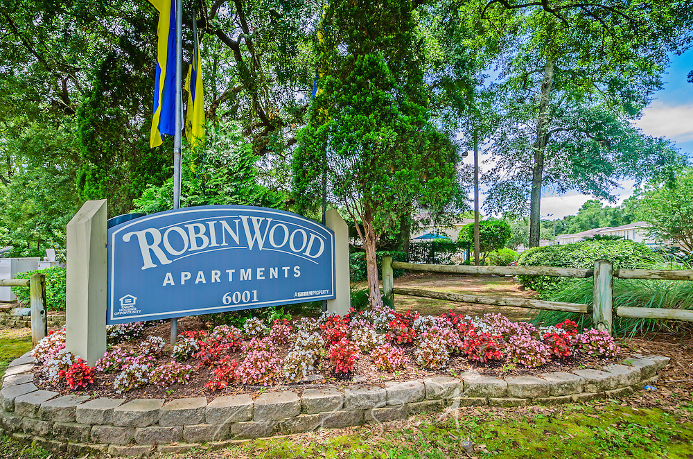 Flowers decorate the sign outside Robinwood Apartments, June 11, 2015, in Mobile, Alabama. The one-bedroom apartments, located on Old Shell Road, are managed by Sealy Realty. (Photo by Carmen K. Sisson/Cloudybright)