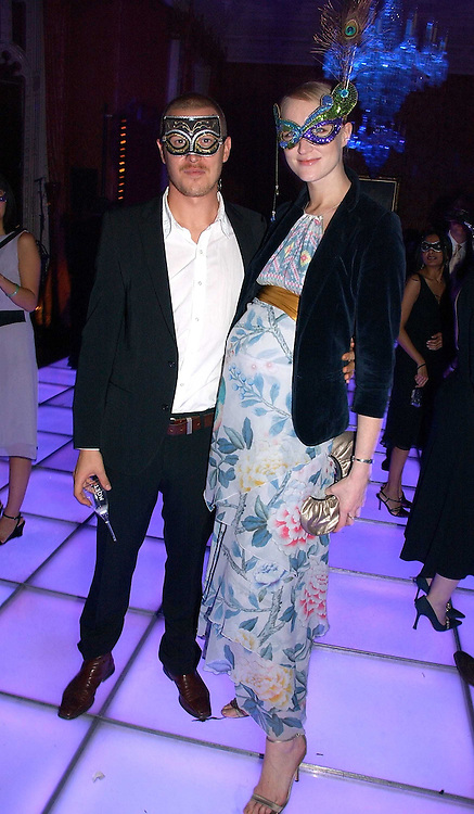 Model  JADE PARFITT and TOBY BURGESS at the 2006 Moet & Chandon Fashion Tribute in honour of photographer Nick Knight, held at Strawberry Hill House, Twickenham, Middlesex on 24th October 2006.<br />