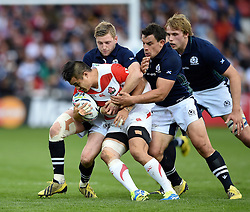 Yu Tamura of Japan is tackled by Finn Russell of Scotland - Mandatory byline: Patrick Khachfe/JMP - 07966 386802 - 23/09/2015 - RUGBY UNION - Kingsholm Stadium - Gloucester, England - Scotland v Japan - Rugby World Cup 2015 Pool B.