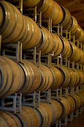 Wine barrels in a vinyard barrel room