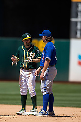 OAKLAND, CA - JULY 23:  Billy Burns #1 of the Oakland Athletics talks to R.A. Dickey #43 of the Toronto Blue Jays at second base during the eighth inning at O.co Coliseum on July 23, 2015 in Oakland, California. The Toronto Blue Jays defeated the Oakland Athletics 5-2. (Photo by Jason O. Watson/Getty Images) *** Local Caption *** Billy Burns; R.A. Dickey