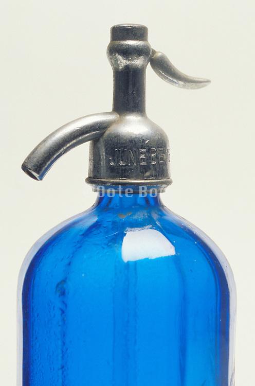 close up of blue antique seltzer water bottle