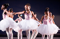 "A group of young ballerinas rehearse for Tulsa Ballet's ""Centre for Dance Education"" year end performance."