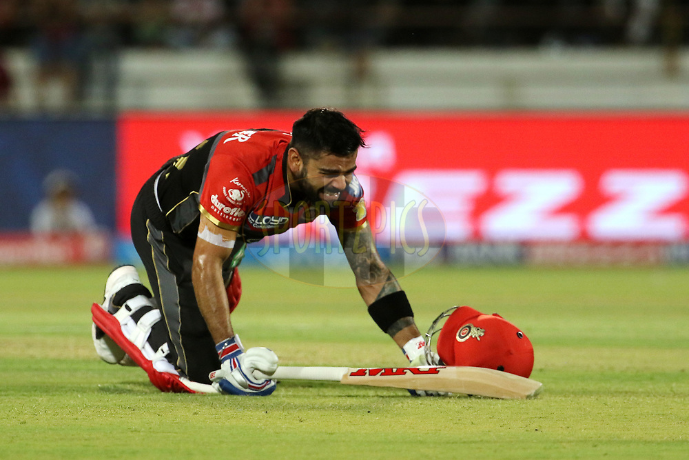 Royal Challengers Bangalore captain Virat Kohli reacts after being hit by a ball during match 20 of the Vivo 2017 Indian Premier League between the Gujarat Lions and the Royal Challengers Bangalore  held at the Saurashtra Cricket Association Stadium in Rajkot, India on the 18th April 2017<br /> <br /> Photo by Vipin Pawar - Sportzpics - IPL