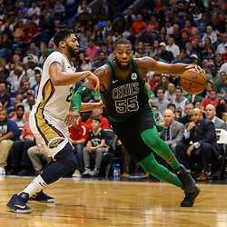 Mar 18, 2018; New Orleans, LA, USA; Boston Celtics center Greg Monroe (55) drives past New Orleans Pelicans forward Anthony Davis (23) during the second half at the Smoothie King Center. The Pelicans defeated the Celtics 108-89. Mandatory Credit: Derick E. Hingle-USA TODAY Sports